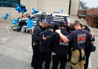 Richardson firefighters from Station 4 paid their respects to Officer David Sherrard on Friday at Richardson police headquarters.(David Woo/Staff Photographer)