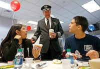 Capt. Jim Dees, Director of Flight with American Airlines, center, talks with Diana Lopez, 16, left, and Alfonso Apodaca, 15, teenage amputee patients from Scottish Rite Hospital, during a ceremony at Dallas-Fort Worth International Airport in DFW Airport, Monday, Feb. 12, 2018.(Jae S. Lee/Staff Photographer)