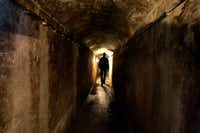 """A visitor strolls through the Vienna sewer during a guided tour. Six decades after """"The Third Man"""" was premiered in London in September of 1949, tourists from around the world pound the Austrian capital's pavements, and even slip into its sewers, to see where the much-acclaimed motion picture was set.(Lilli Strauss/AP)"""