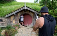 Tourists take photos during a tour of the Hobbit movie set near Matamata, New Zealand.(Mark Baker/AP)