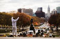 "Alex Carrillo Quito of Ecuador imitates the character Rocky Balboa from the 1976 movie ""Rocky,"" on the steps of the Philadelphia Museum of Art, in Philadelphia.(Matt Rourke/AP)"