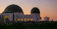 People gather at the Griffith Observatory of Mount Hollywood in Los Angeles' Griffith Park to watch the super blue blood moon. The location is featured in several movies.(Damian Dovarganes/AP)