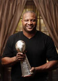 Former Dallas Cowboys running back Lincoln Coleman, pictured at his childhood home in Dallas on November 26, 2013., with the Super Bowl Trophy from 1993.(Michael Ainsworth/Staff Photographer)