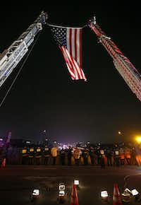 Firefighters and police officers salute as the procession of fallen Richardson police officer David Sherrard en route to Sacred Heart Cemetery on Highway 75 in Richardson, Texas, Tuesday, Feb. 13, 2018.(Jae S. Lee/Staff Photographer)