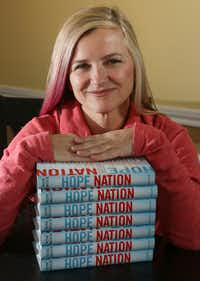 Rose Brock, who is a professor of library science, poses with her new book, 'Hope Nation,' in her Grapevine  home. The book is a collection of essays by writers of young adult fiction, published by Penguin Random House. (Ron Baselice/Staff Photographer)