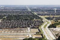 Established neighborhoods, new homes and homes under construction are seen in McKinney in 2016.(Vernon Bryant/Staff Photographer)