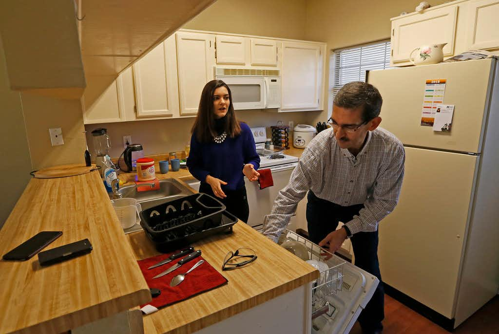 Sara Mohammed Saleem (left) talks with her father Faris Saleh in the kitchen at their home in Plano, Texas, Thursday, Feb. 1, 2018. (Jae S. Lee/The Dallas Morning News)(Jae S. Lee/Staff Photographer)