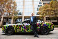 A custom-wrapped 2015 Dodge Challenger Hellcat is just one the expensive vehicles in the collection owned by Cliff Fischer, chairman and CEO of Dallas tenant representation firm Fischer & Co.(Ashley Landis/Staff Photographer)