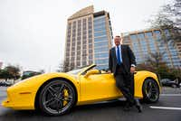 Cliff Fischer poses with his 2018 Ferrari 488 Spider outside Fischer & Co. headquarters in Dallas. (Staff Photographer/Ashley Landis)