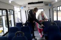 Envoy America driver Kris Werner helps Jeannyne Reston select a seat on the bus at The Heritage at Twin Creeks in Allen.  The group of seniors was heading to Texas Roadhouse for lunch. (Anja Schlein/Special Contributor)