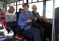 Joan Giles (left) sits next to Lorene Mathis as they wait for their Envoy America bus to leave The Heritage at Twin Creeks in Allen. (Anja Schlein/Special Contributor)