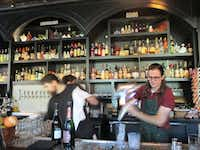 <p>Bartenders mix creative, fun cocktails at Sundry and Vice, an apothecary-speakeasy mash-up.&nbsp;</p>(Robin Soslow/Special Contributor)