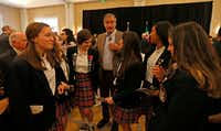 Former Mexican President Vicente Fox, center, talks with students from Ursuline Academy Of Dallas during the World Affairs Council's International Educator of the Year event at Belo Mansion in Dallas, Monday, Feb. 19, 2018.(Jae S. Lee/Staff Photographer)