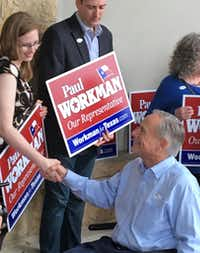 """<p><span style=""""font-size: 1em; background-color: transparent;"""">Gov. Greg Abbott urged voters to avoid long lines by casting early votes, as he did Tuesday in Austin. (</span><span style=""""font-size: 1em; background-color: transparent;"""">Robert T. Garrett/The Dallas Morning News)</span></p>"""