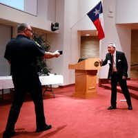 Capt. Dan Birbeck of the Dallas County Hospital District Police Department (left) created a live shooter scenario with Steve Love, president and CEO of the Dallas-Fort Worth Hospital Council, during the council's active shooter training seminar Wednesday at Texas Scottish Rite Hospital for Children.(David Woo/Staff Photographer)
