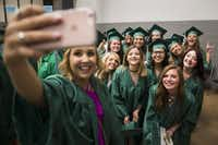 Katelynn Blasavage (center) poses for a selfie with fellow UNT graduates before they process into the coliseum for graduation on May 14, 2016, in Denton. (Smiley N. Pool/Staff Photographer)