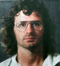 Branch Davidian leader David Koresh in a police line-up following a 1987 gunbattle between Davidians. (AP Photo/Waco Tribune-Herald)