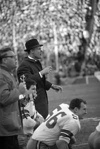 In this Jan. 1, 1967, photo, Dallas Cowboys coach Tom Landry shouts to his players on the field during the NFL championship game against the Green Bay Packers in Dallas.(The Associated Press)