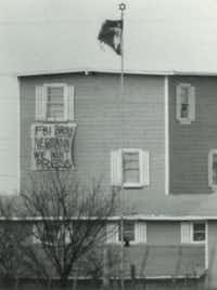 "<p>People inside the compound lowered a banner outside a window on M<span style=""font-size: 1em; background-color: transparent;"">arch 14, 1993,</span><span style=""font-size: 1em; background-color: transparent;""> that read, ""FBI Broke Negotiation"" We Want Press.""</span></p>(The Dallas Morning News/Irwin Thompson)"