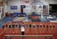 Gymnasts line up on the floor at the end of a training session in 2008 to listen to Martha Karolyi, then-national team coordinator, at the Karolyi Ranch near New Waverly.(Tom Fox/The Dallas Morning News)