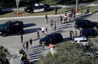 In this Wednesday, Feb. 14, 2018, file photo, students held their hands in the air as they were evacuated by police from Marjory Stoneman Douglas High School in Parkland, Fla., after a shooter opened fire on the campus, killing 17 people.(Mike Stocker/AP)