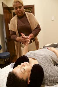 Licensed massage therapist Thalia Jackson Abdelrahim massages Marsha Conley's hand during a massage therapy session at Legacy Salons & Day Spa in Mansfield.(Brandon Wade/Special Contributor)