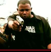Jayson Moore points a handgun in one of his rap videos(Youtube)