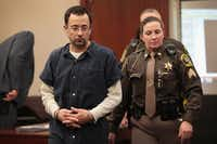 <p>Larry Nassar appears in court to listen to victim impact statements after being accused of molesting girls while he was a physician for USA Gymnastics and Michigan State University. Nassar pleaded guilt in Ingham County, Mich., to sexually assaulting seven girls.</p>(Scott Olson/Getty Images)