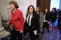 <p>Former champion gymnast Jeanette Antolin (center), with Sen. Dianne Feinstein, took part in a news conference with members of Congress on Jan. 30, 2018, regarding legislation to require amateur athletics governing bodies to report sex-abuse allegations.</p>(Chip Somodevilla/Getty Images)