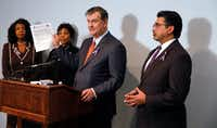<p>Dallas Mayor Mike Rawlings  holds a copy of the Domestic Violence Lethality Screen for First Responders doing a news conference Friday  at the Genesis Women's Shelter with Dallas County District Attorney Faith Johnson (left), Dallas Police Chief U. Renee Hall, and Judge Roberto Cañas of County Criminal Court #10 to discuss stronger enforcement of the gun surrender program, which takes guns from domestic abusers.</p>(David Woo/Staff Photographer)