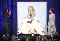 Former U.S. first lady Michelle Obama (L) and artist Amy Sherald unveil her portrait during a ceremony at the Smithsonian's National Portrait Gallery, on Feb. 12, 2018 in Washington, DC.(Mark Wilson/Getty Images)