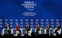 From left, Martin Wolf, associate editor and chief economics commentator of the <i>Financial Times</i> newspaper; Christine Lagarde, managing director of the International Monetary Fund;  Mark Carney, governor of the Bank of England; Carrie Lam, chief executive of Hong Kong SAR; Haruhiko Kuroda, governor of the Bank of Japan; and Callahan Erdoes, CEO asset and wealth management of JPMorgan Chase & Co., attend a discussion during the annual meeting of the World Economic Forum in Davos, Switzerland on Jan. 26, 2018. (AP Photo/Markus Schreiber)
