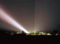 A spotlight shines over the compound. Agents flooded the Davidians with light and blasted the compound with music and noises.(Rick Bowmer/The Associated Press)