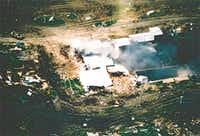 A photo taken from an FBI aircraft just after noon on April 19 as fire first broke out in the compound.(FBI)