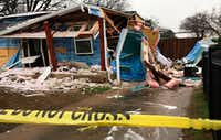 A gas explosion rocked this house Friday, sending five people to the hospital in the 3500 block of Espanola Drive in Dallas. (Tom Fox/Staff Photographer)