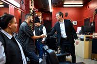 Democratic Senate candidate Beto O'Rourke shakes the hand of barber Ivan Dominguez, 26, of Bishop Barbers as the candidate met with local business owners before conducting a town hall meeting at the Texas Theater in Oak Cliff on Friday, Feb. 23, 2018. (Ben Torres/Special Contributor)