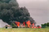 Fire engulfs the compound on April 19, 1993, after federal agents inserted tear gas into the building in an attempt to end the 51-day-old standoff and the Branch Davidians responded by setting the blaze.(Susan Weems/The Associated Press)