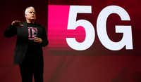 T-Mobile Chief Technology Officer Neville Ray details T-Mobile's plans to build a nationwide 5G network in the U.S. at Mobile World Congress on Tuesday in Barcelona, Spain.(Manu Fernandez/The Associated Press)