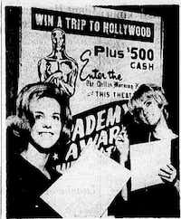"""Photo from the March 27, 1965 edition of <i>The Dallas Morning News</i>: """"Mary Wilson of Wichita Falls and Aline West of Dallas, a pair of SMU co-eds, get ready to mark their ballots in the Academy Award Sweepstakes contest""""(Dallas News Staff Photo)"""