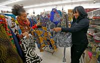 Owner Akwete Tyehimba (left) shows regular customer Nia Khepera some dresses.(Jae S. Lee/Staff Photographer)