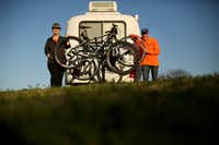 With a bike rack installed on their trailer, Keven Ann Willey and Georges Badoux crossed off one of the many items on their to-do lists.  (Andy Jacobsohn/Staff Photographer)