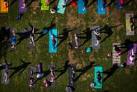 Dallas Yoga Center hosts a yoga class at Kylde Warren Park on Saturday, March 25, 2017, in Dallas, TX. (Smiley N. Pool/The Dallas Morning News)(Smiley N. Pool/Staff Photographer)