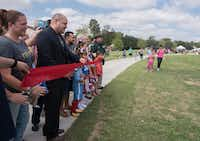 Dallas City Council Member Adam Medrano cuts a ribbon during the grand opening of Buckner Park on Saturday, Oct. 7, 2017. The park went though a 3 million dollar upgrade.(Rex C Curry/Special Contributor)