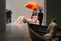 Ron Mueck's couple Under An Umbrella and Man in Boat are shown during a preview of an exhibit of Mueck's sculptures at the Museum of Fine Arts Houston(Brett Coomer/Houston Chronicle)