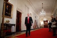 President Donald Trump walks through the White House.(Tom Brenner/The New York Times)