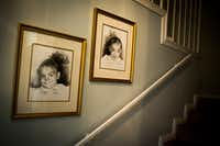Baby images of Kara Zartler and her twin sister, Keeley, hang in the stairwell of the family home in Richardson. The girls were born three months premature. Keeley developed normally, but at 15 months, Kara was diagnosed with cerebral palsy.(Smiley N. Pool/Staff Photographer)