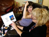 Christy Zartler reads a specially prepared book to daughter Kara to prepare her for probate court.(David Woo/Staff Photographer)