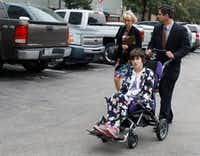 Christy and Mark Zartler take their daughter, Kara, with them to probate court in downtown Dallas to try to remain her legal guardians.Judge Brenda Hull Thompson ruled in favor of the parents.(David Woo/Staff Photographer)