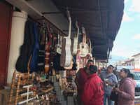 Local vendors in Paracho can't keep up with demand for the white guitar featured in the animated movie <i>Coco</i>.(Alfredo Corchado/Staff)