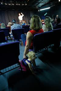 Amy Pramuk holds her child Evey Cordray, 2, as U.S. Congressman Beto O'Rourke makes a speech at the Emporium for the Arts in Woodville, Texas on Feb. 9, 2018. O'Rourke is running for the U.S. Senate. (Nathan Hunsinger/The Dallas Morning News)(Nathan Hunsinger/Staff Photographer)
